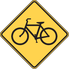 Signs like this one will be used to remind drivers to share the road with cyclists. The combination of a bicycle symbol and left/right bi-directional arrows underneath will signify bicycle crossing.