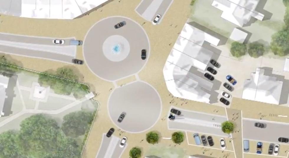 Creative street design reunites a village divided for Shared space design